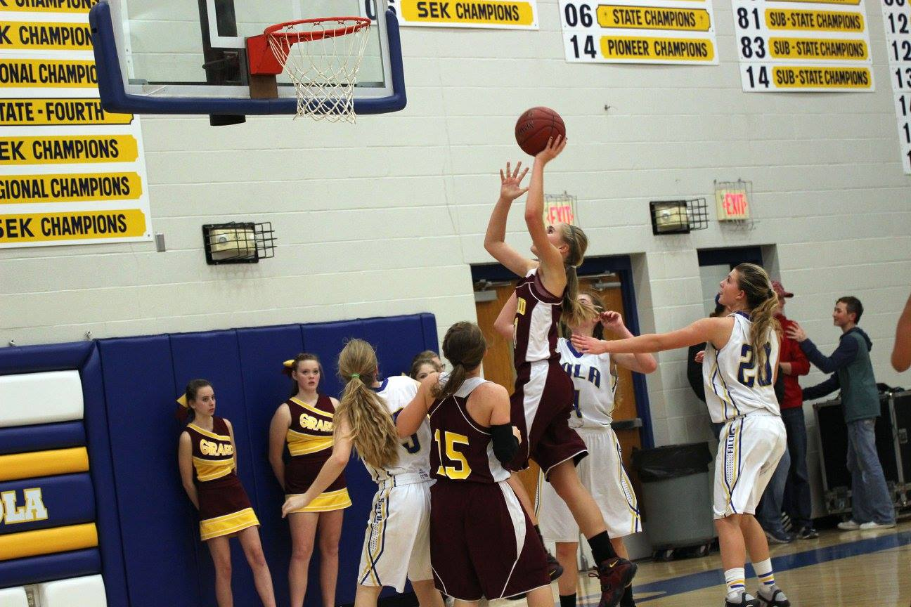 Calea Augustin led the Lady Trojans in their season opening victory with 15 points. PHOTO BY JOYCE KOVACIC