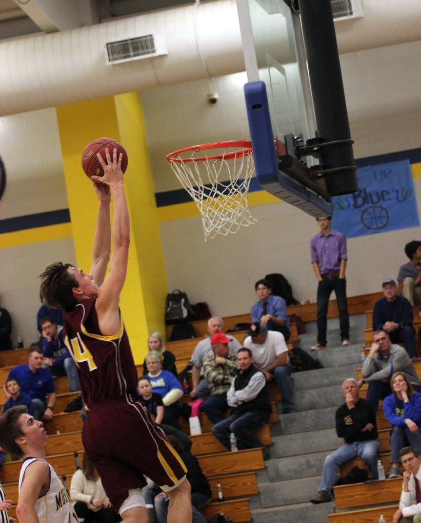 Drew Davied slams home two of hit team leading 17 points in the Trojans 67-36 route over Iola on Friday night. PHOTO BY JOYCE KOVACIC