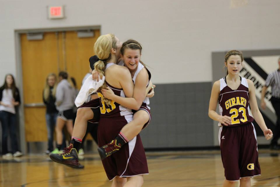 Jacey Murphy jumps into the arms of high point scorer Ashley Ray after their dramatic win over Frontenac Tuesday night.  PHOTO BY JOYCE KOVACIC
