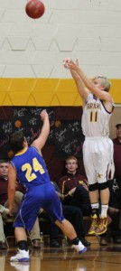 Laike Damman lead the Trojans with 20 points in their opening night victory over the Iola Mustangs Friday night.