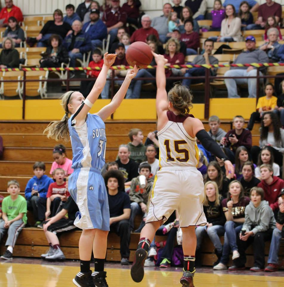 Jacey Murphy blocks a shot in the Lady Trojans win over Southeast Friday night. PHOTO BY JOYCE KOVACIC