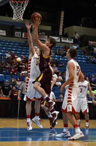 Kross Hamblin, sophomore for the Girard Trojans, lays it in during the third quarter of semi-finals at 4A State. Although the sixth-seeded Trojans pulled within three at the end of the quarter, Concordia prevailed with a 77-63 victory. (PHOTO by Julie Jones)