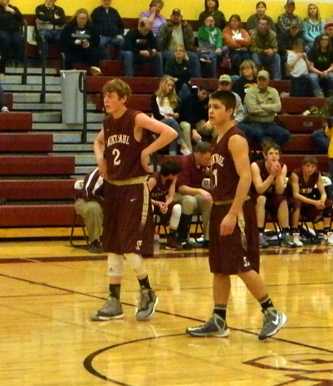 Noah Winter (R) sunk two free throws with 1.2 seconds left in the game, advancing the Indians to the sub-state championship.