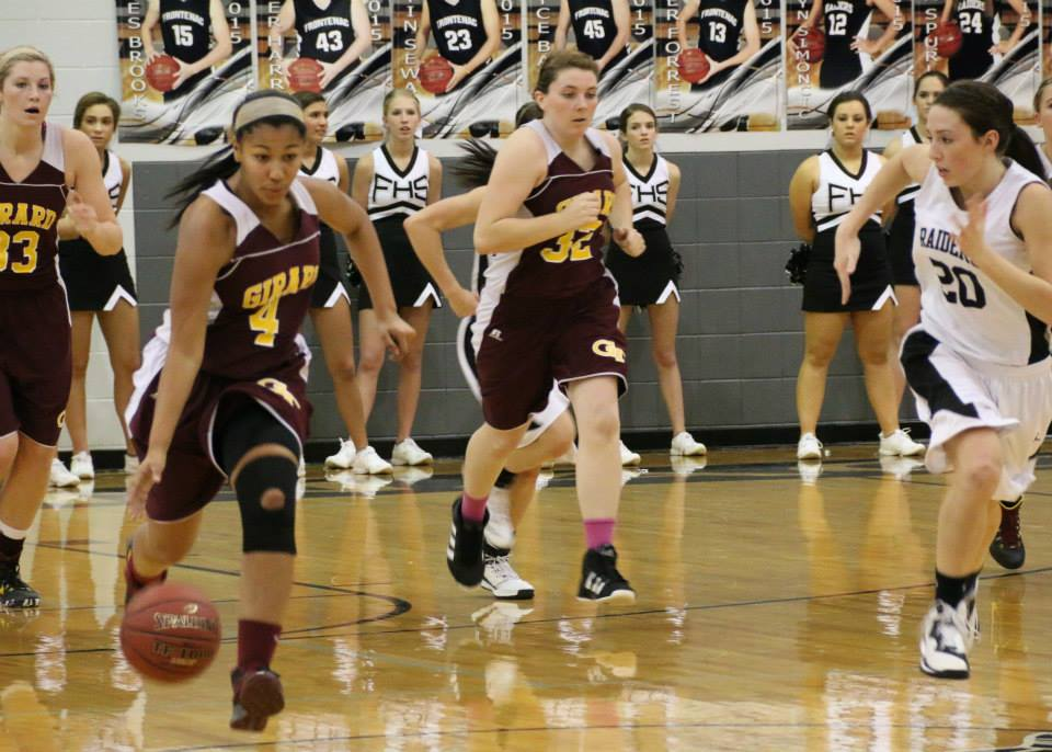 Olivia Hanson and the Girard Trojans win a thriller over the Frontenac Raiders 56-55.